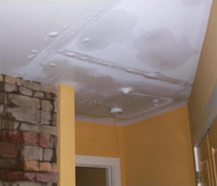 a picture of a water damaged ceiling
