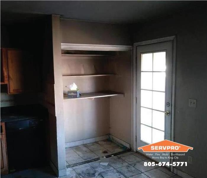 a picture of a kitchen with soot damage