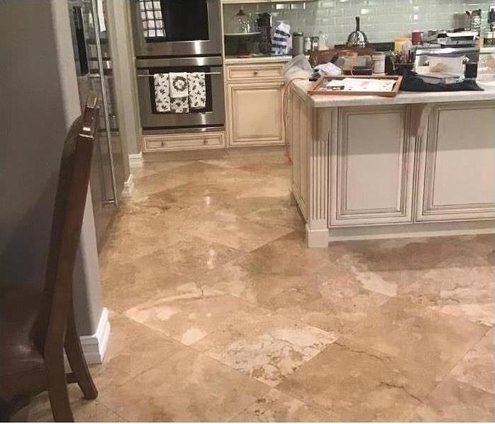 a picture of a wet kitchen floor