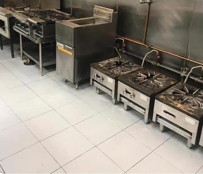 a picture of a restaurant kitchen after it has been cleaned because of a fire