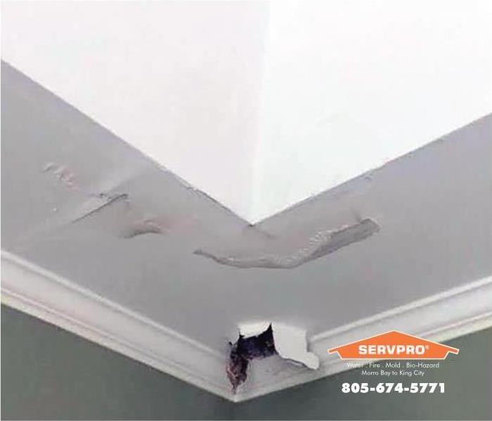a picture of a ceiling with water damage