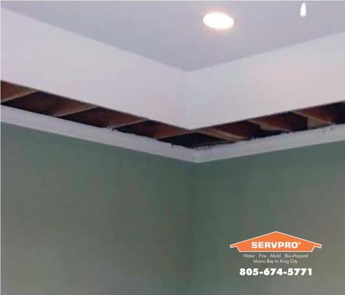 a picture of the ceiling with water damage that has been cut out