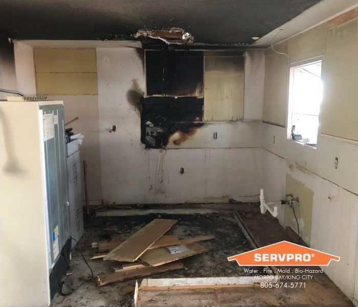 a picture of a kitchen after a fire